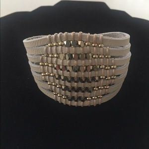 Faux-leather bracelet with gold beads.